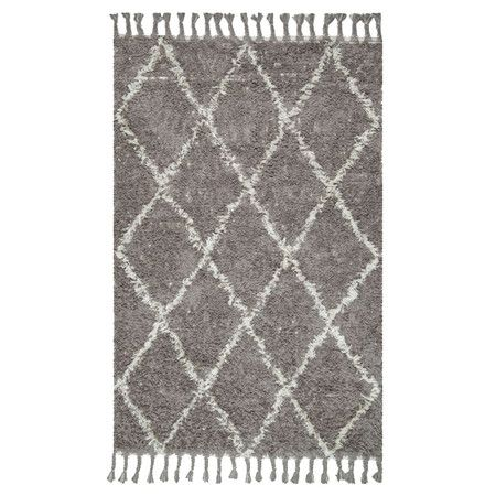 Lend a touch of texture to the master suite or anchor a vibrant seating group in the den with this hand-knotted wool shag rug, featuring a classic trellis mo...