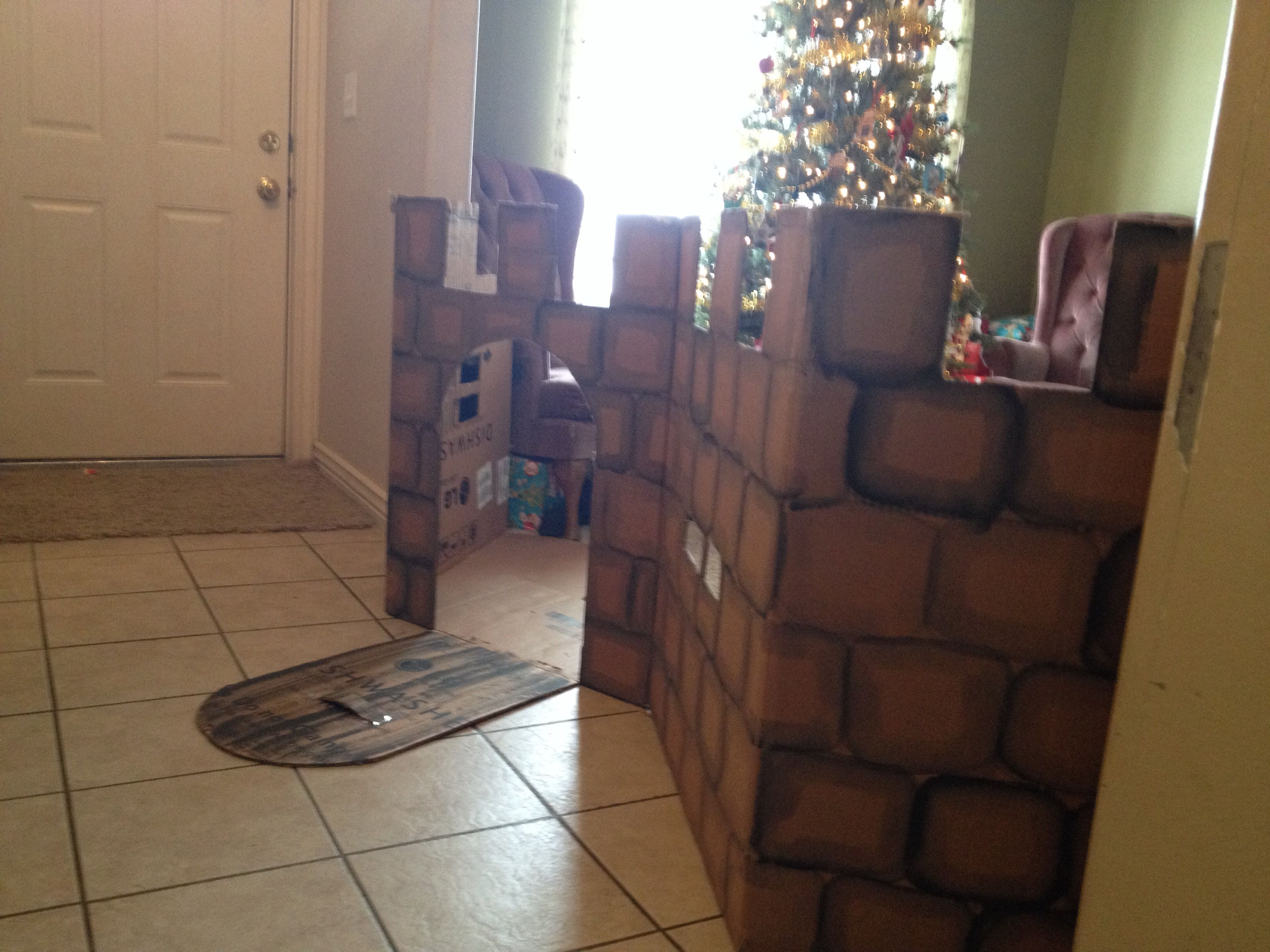 Christmas castle: surprise the kids on Christmas with a card board box decorated like a castle guarding the presents! Great for adventurous little boys!