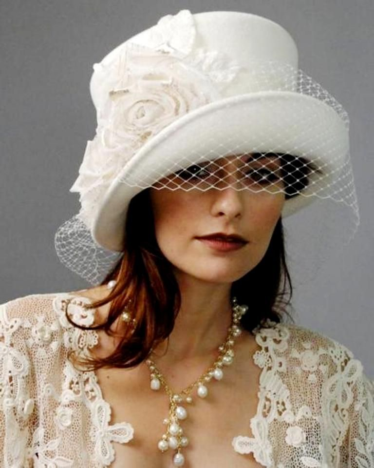 Headpieces For Wedding Guests: A Regal Hat Fit For The Queen.