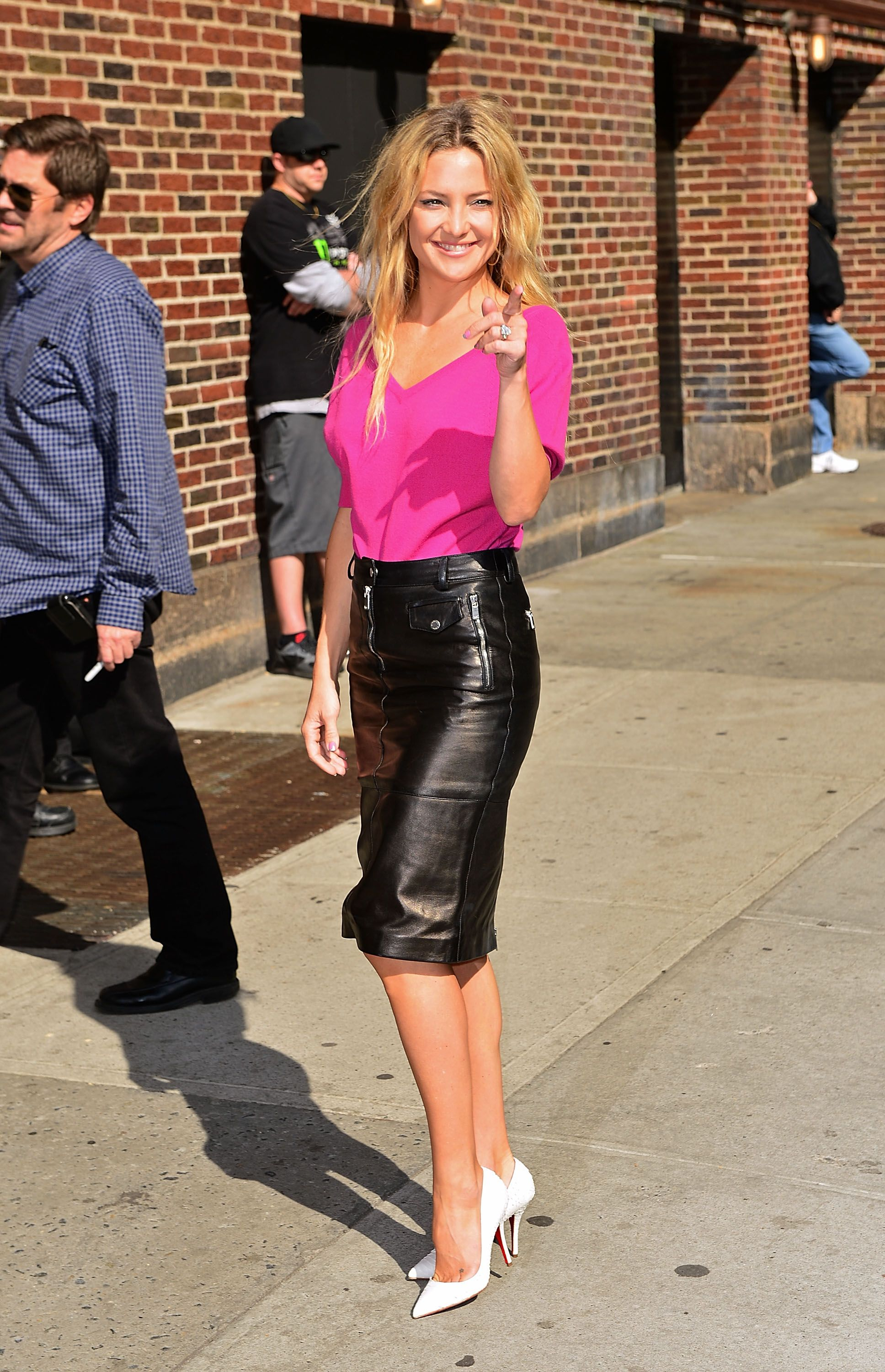 Kate Hudson wore a bright pink top and black leather skirt and white pumps  for her appearance on The Late Show in NYC. 9f0369f33
