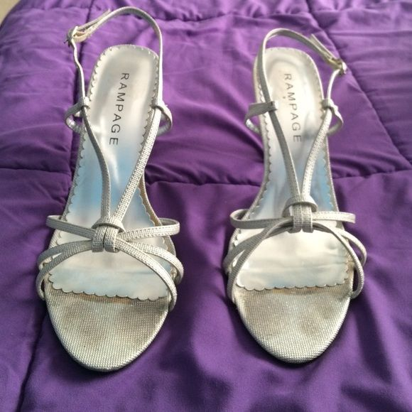 Strappy silver sandal Rampage heels, worn twice with a few stains on the heel and the top but overall good condition Rampage Shoes