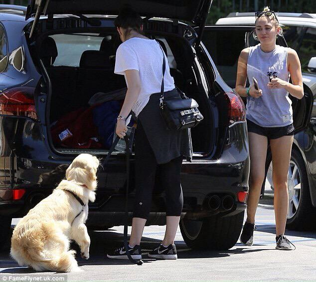 Miley out with a friend