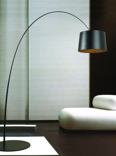 Add a contemporary touch to your home with this arc shaped floor lamp perfect
