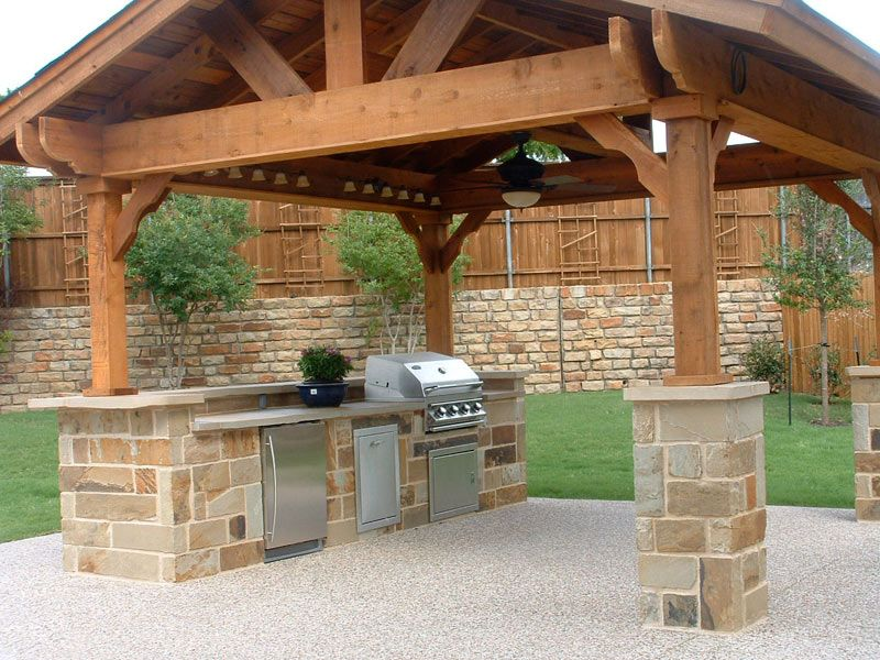 romantic outdoor kitchens ideas in wooden gazebo at night with