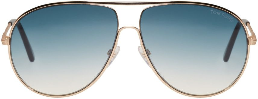 06704ae03773 Tom Ford for Women Collection. Metal-frame aviator sunglasses in gold-tone. Blue  gradient lenses with 100% UV protection. Logo engraved at lens.