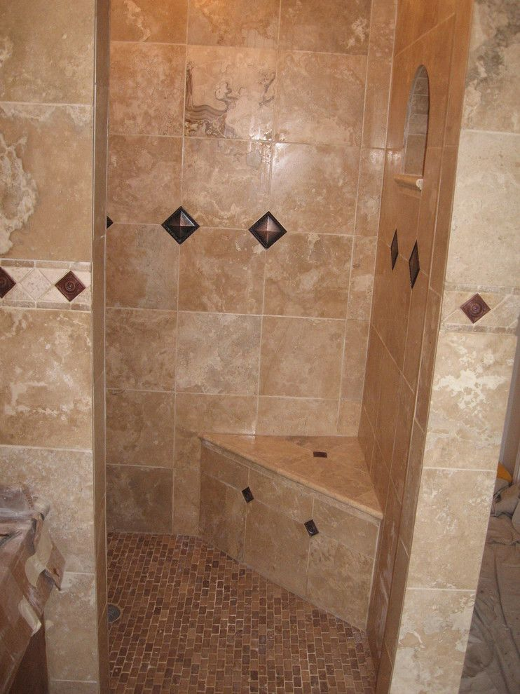 corner bench tiled shower copper and bronze earth tones | Bathroom ...