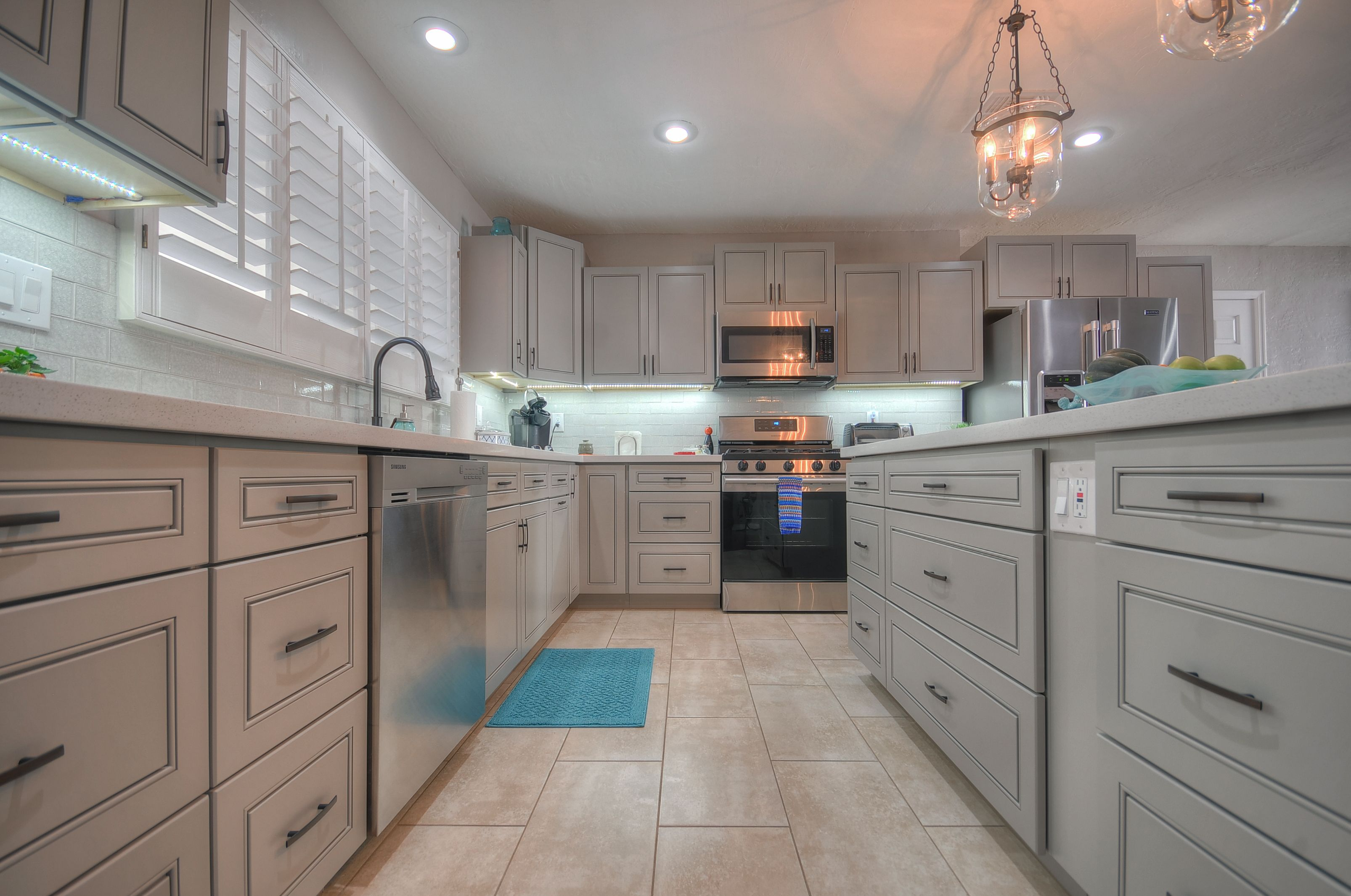 Best This Kitchen Features J K's Greige Grey Cabinetry With 640 x 480