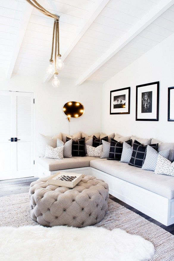 White And Black Lounge Nook With A Giant Tufted Ottoman