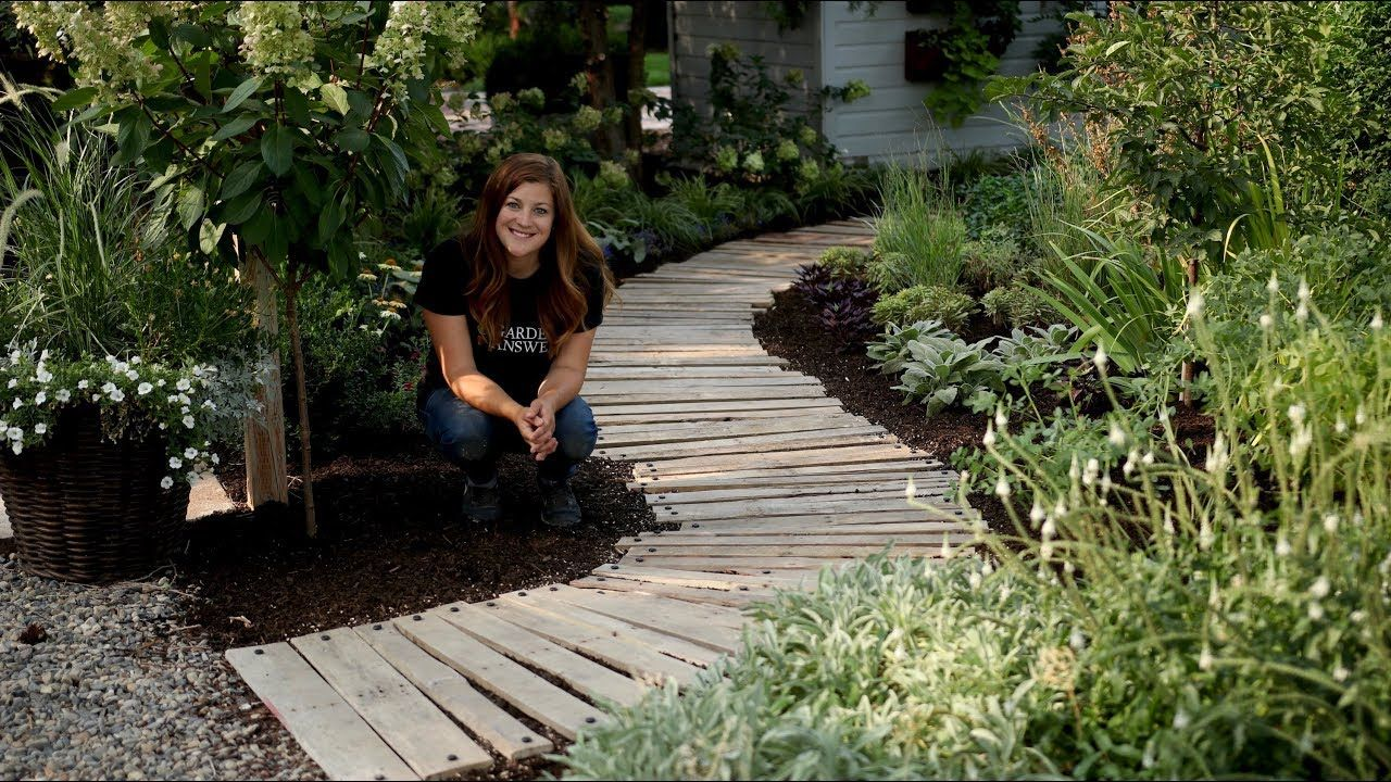 Diy Pallet Walkway Garden Answer This Youtube Channel Is Great Laura Has So Much Enthusiasm And Energy In Pallet Walkway Backyard Walkway Garden Walkway