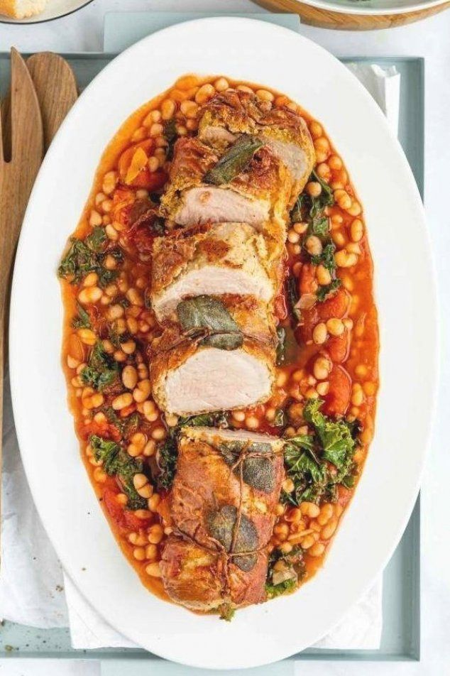 Pork Tenderloin Wrapped in Prosciutto is a delicious and easy recipe  made in less than one hour  Served with a light tomato and white bean sauce  It looks festive and fancy  but it   s really simple to make and incredibly flavorful  Perfect for Christmas dinner or Sunday roast  #porkrecipes #porktenderloin #porkroast #tomatoandbeans #christmasdinner #sundayroast