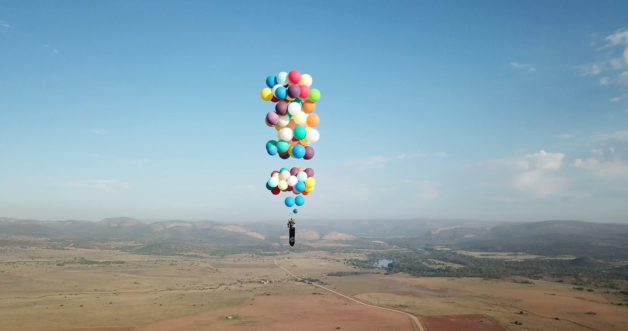 Man takes flight 8,000 feet up in the air using 100 helium