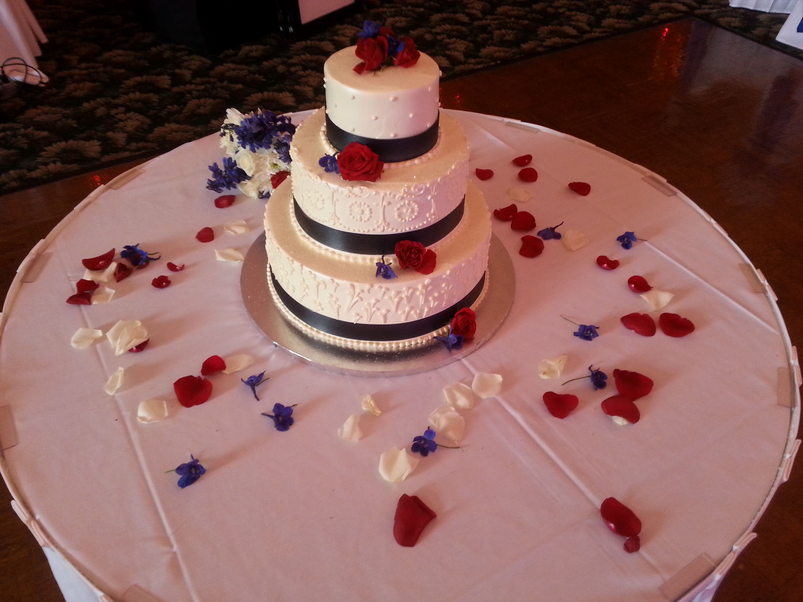 Dressed Cake With Red Roses And Blue Delphinium For A July 5th Summer Wedding Cake Dress Cake Wedding Cakes