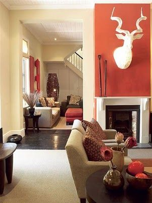 I love the pumpkin y orange accent wall living room fire - Orange and cream living room ideas ...