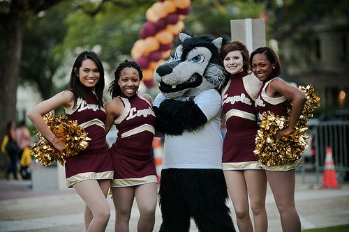 The Mascot and cheerleaders at the Centennial Kick Off - Founder's Day  Celebration for Loyola University