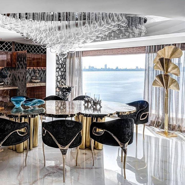 Today Inspiration - Ideas & Trends | An incredible and glamorous apartment all designed by @zzarchitects. Fortuna #diningtable by @bocadolobo gives a unique touch to the project  #CovetHouse #moderndesign #interiorarchitecture #luxurydesign #modernliving #topinteriorstyle #interiortrends #designcrush #myinterior #designdecor #diningroom #diningroomdesign #diningroomdecor #diningroominspiration #diningtable #tables #diningtabledecor #moderndiningtable #light #lighting #lightdesign #diningchairs #