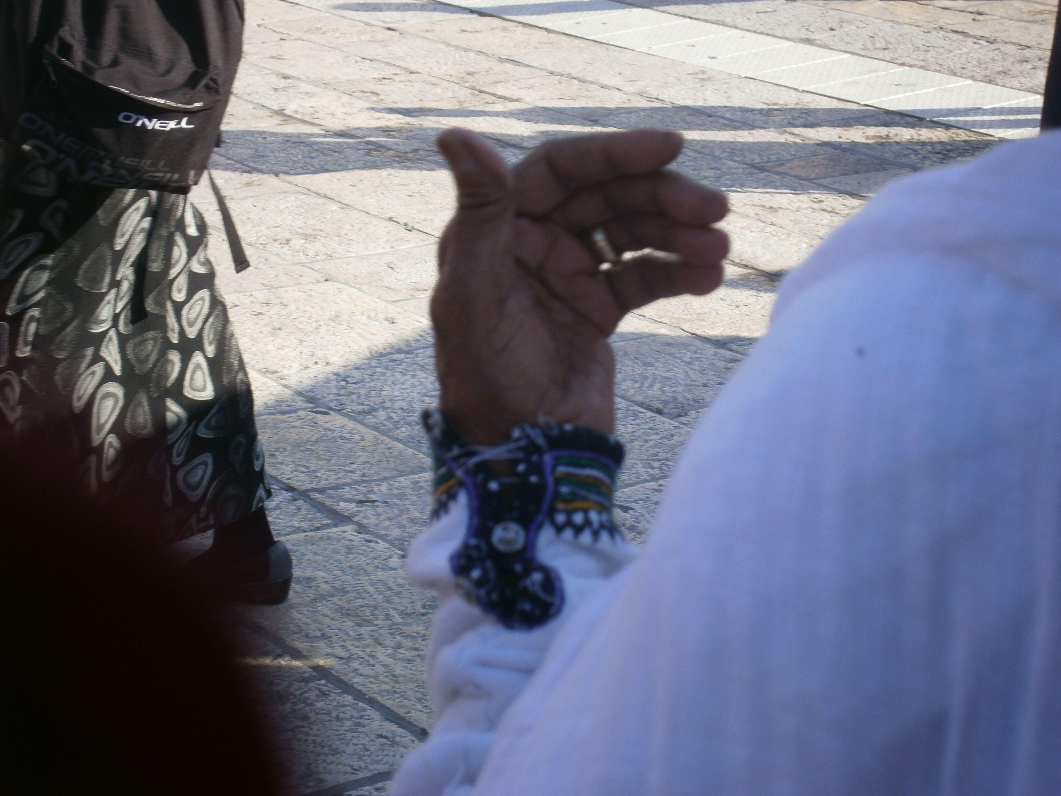 the hand of an elderly Ethiopian woman praying at the Western Wall during Bircat Kohanim Succot.