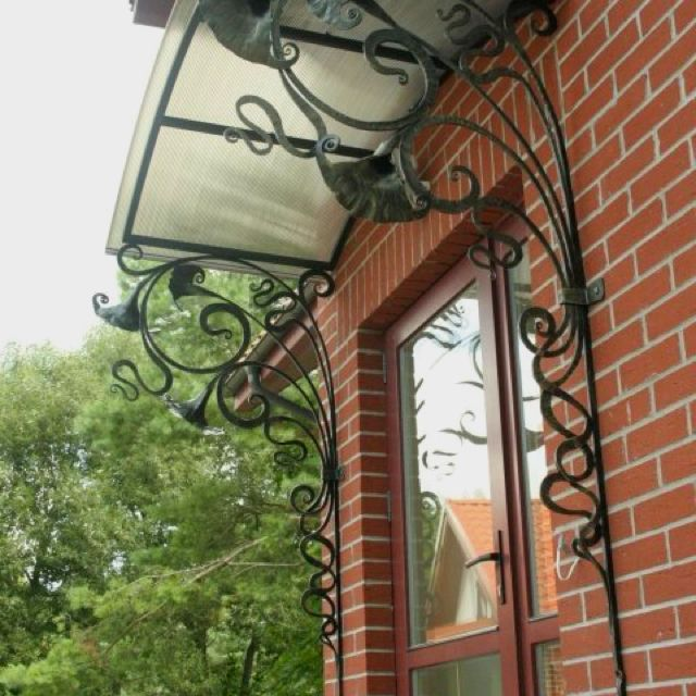 Really Cool Forged Iron Gussets To Support An Awning