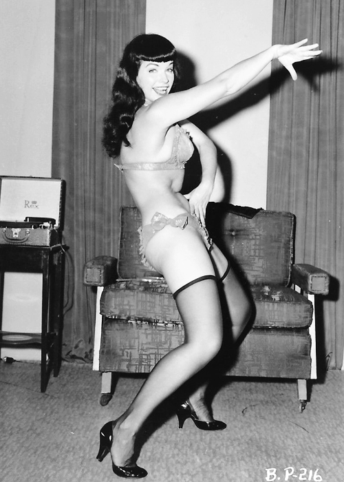 Bettie Page photographed by Irving Klaw, c. 1950s.