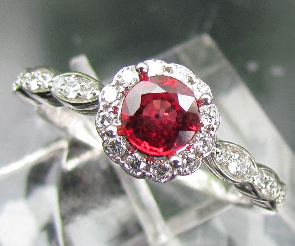 Ruby engagement ring in k gold and diamond halo setting matching