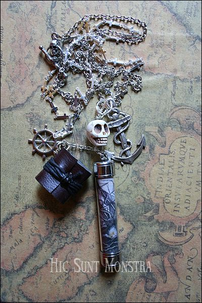 """https://www.facebook.com/hicsuntmonstra  """"The Sargassi Diaries"""" - the necklace celebrating the long and aventurous voyages with a composition of marine elements, a small diary, a skull and a cilindric dome with an old image inside, representing a moster attack to a vessel. Enjoy the dark charm of this creation, which will surely capture the attention of all the strangers you will meet on your perilous roads."""