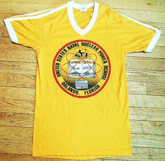 375f59329 United States Naval Nuclear Power School, Orlando, Florida seal on t-shirt  v neck yellow vintage 70's 80's atom atomic submarine