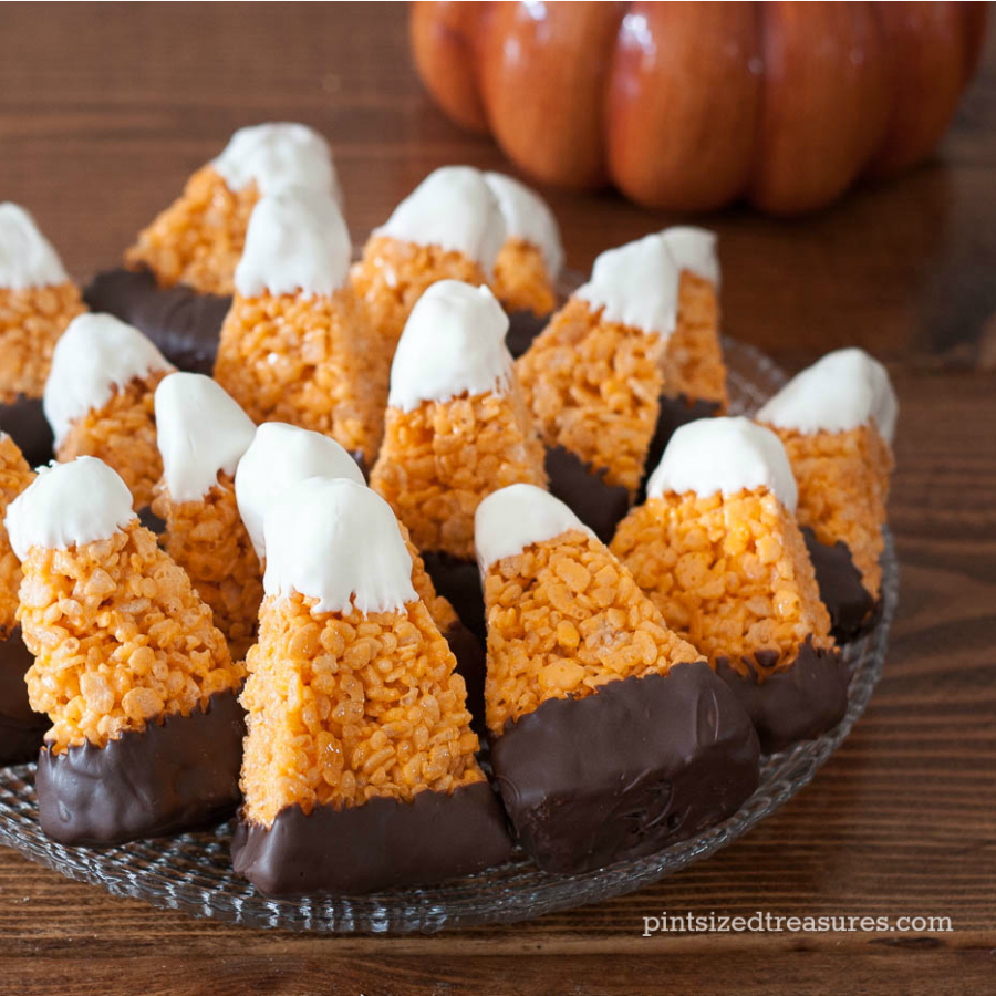 Probier das hier einmal aus: Chocolate Dipped Candy Corn Rice Crispy ...