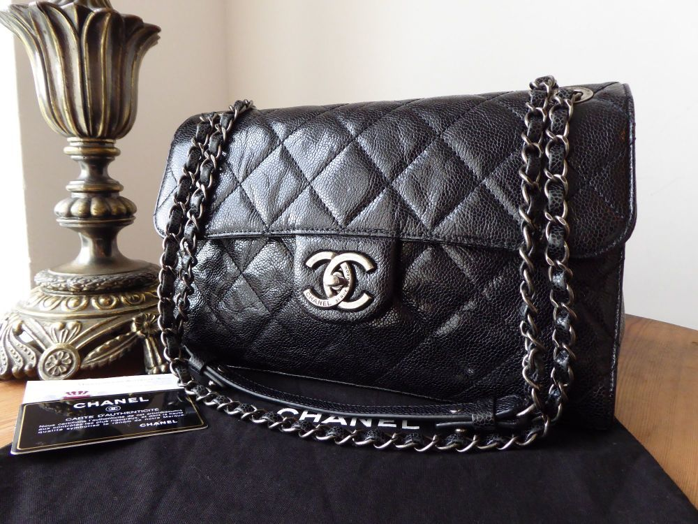 42e16a51935e A fabulous distressed patent finish and edgy, dark gunmetal hardware, its  an absolutely beautiful piece.