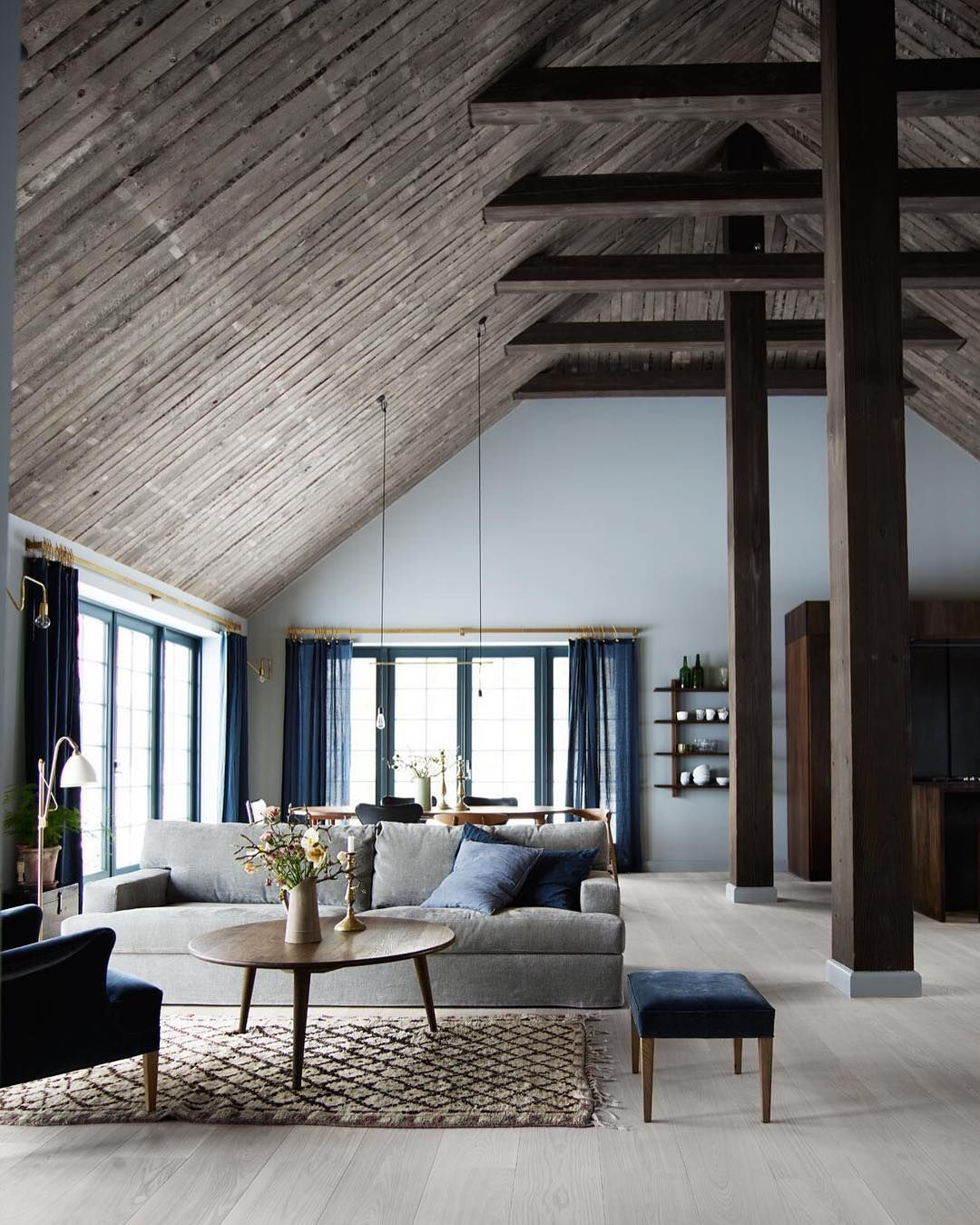 Open living area in the home of Danish Photographer Mikkel Adsbøl which he and his wife modeled after an old barn located near Copenhagen. by roomporn