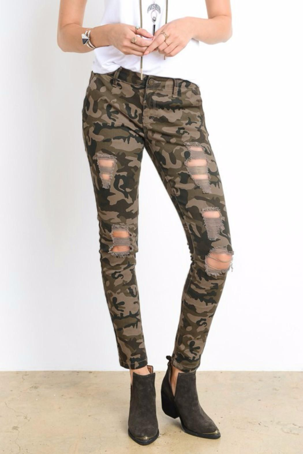 14b23ea9a5a Distressed camo print Jeggings. They feature a button and zipper like