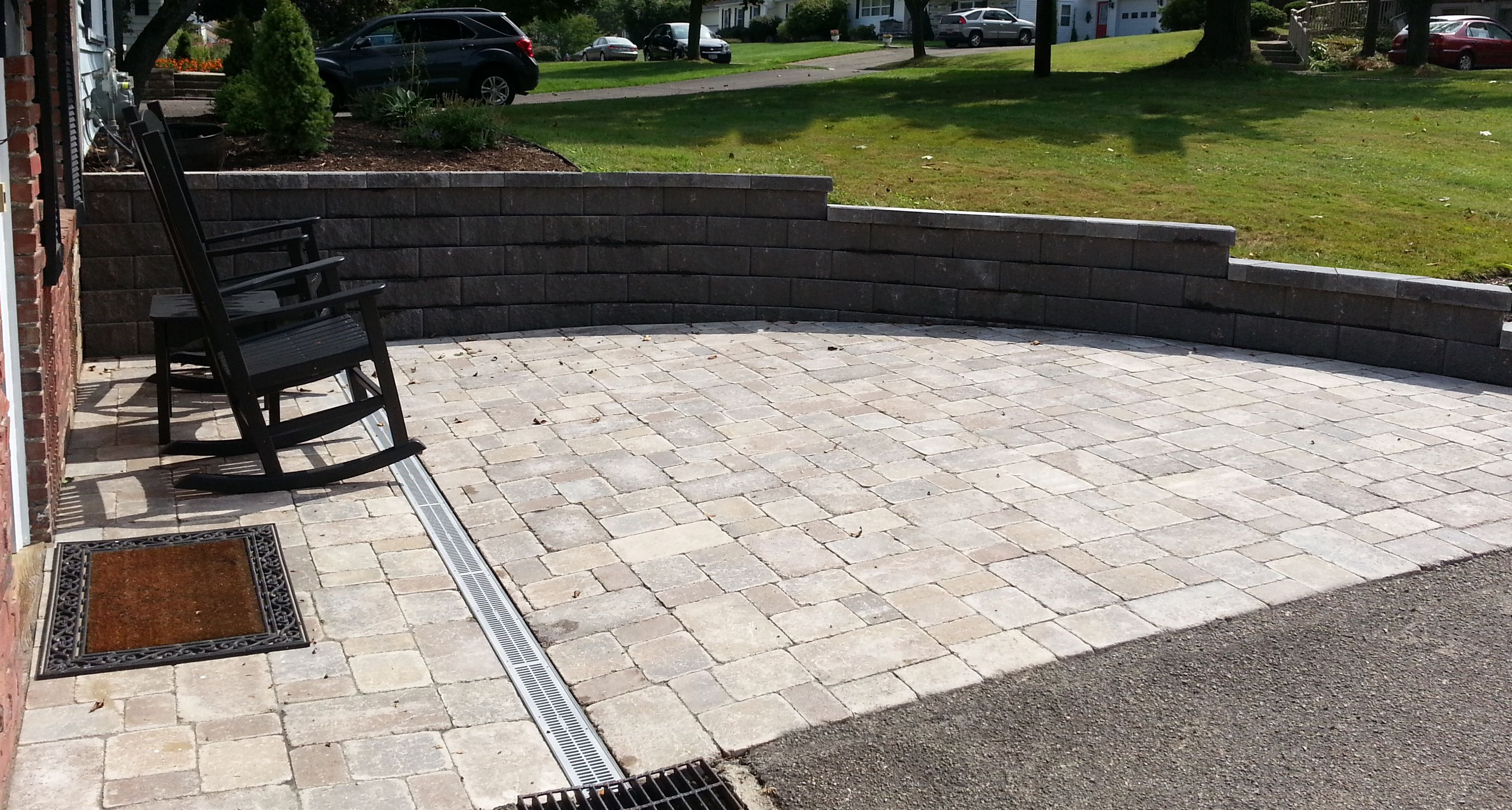 Paver Patio With Drain System And Retaining Wall