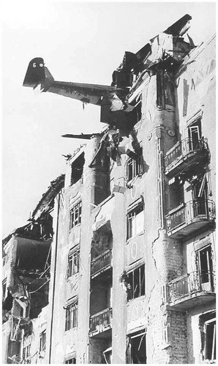 Berlin 1945 -- a plane hangs from the top of a five-story