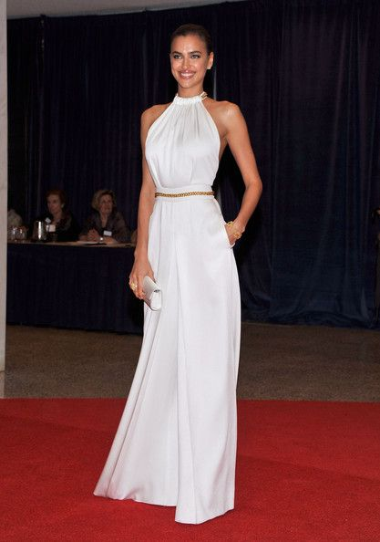3920aff228f Irina Shayk in a YSL white chain Jumpsuit and pulled back hair - Summer chic