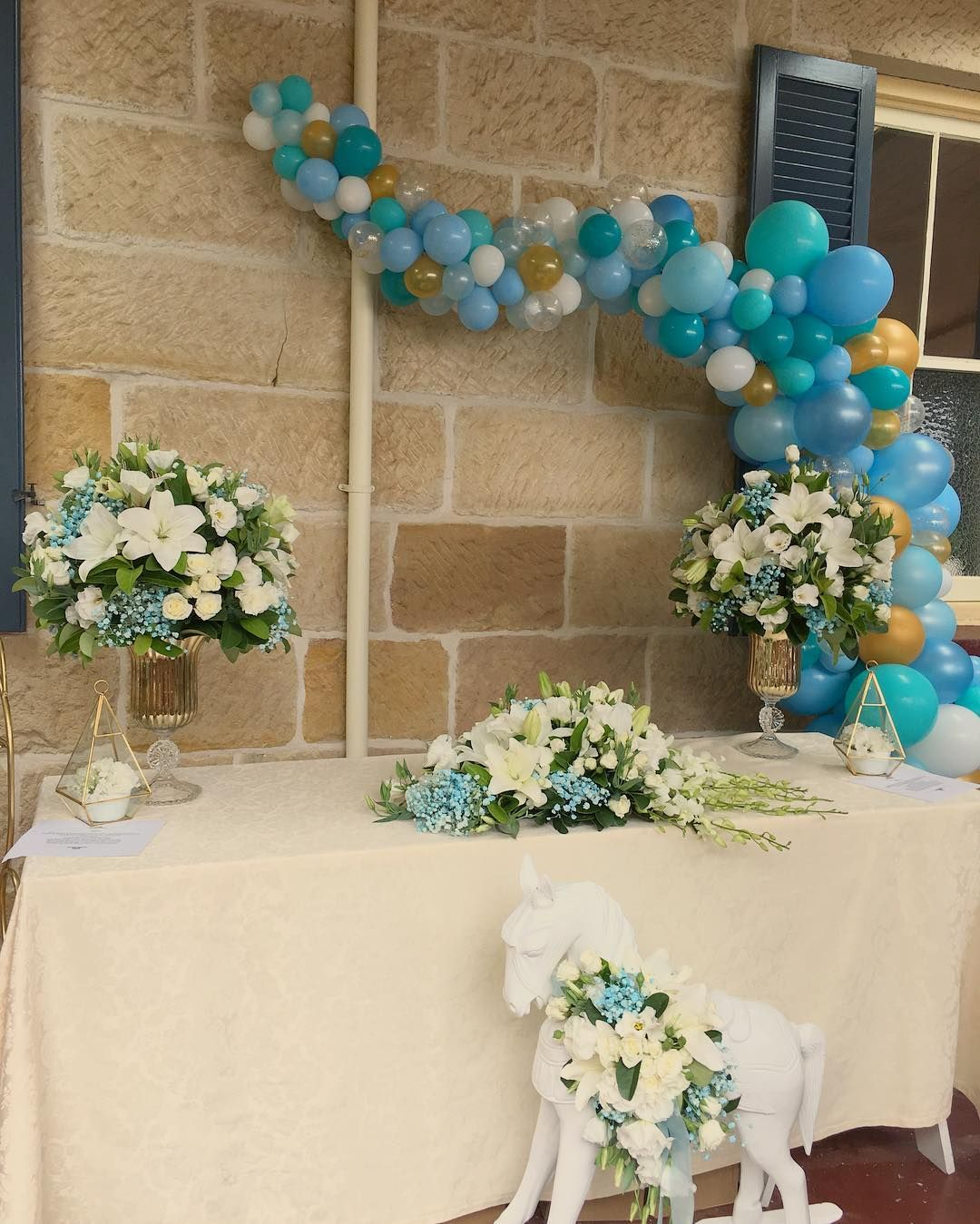 Blues white and gold balloon decorations for a baby boy Christening