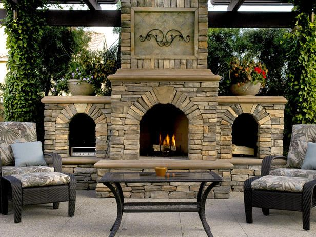 towering outdoor stone fireplace