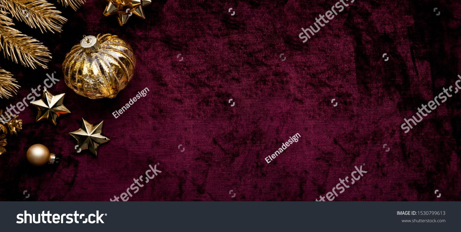 Merry Christmas and Happy Holidays greeting card frame banner New Year Christmas golden ornaments on purple background top view Winter holiday theme Flat lay