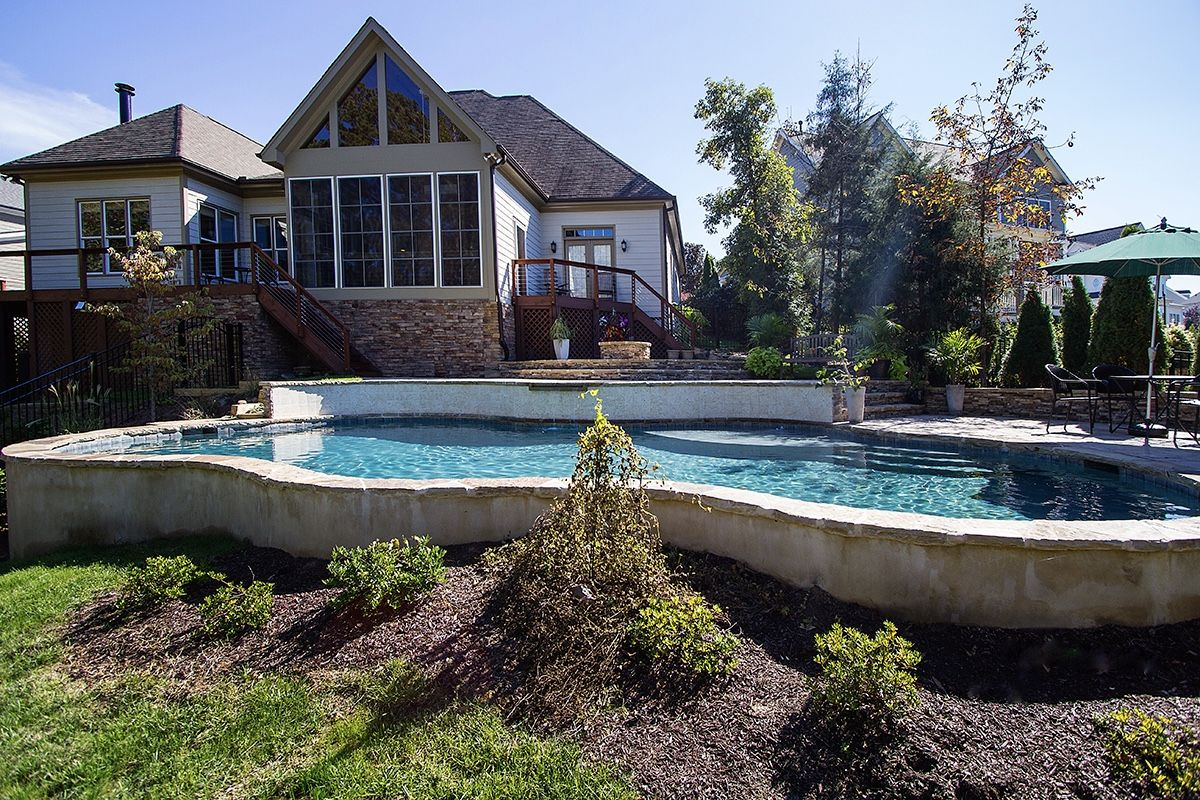Lovely pool built on a lot with extreme yard slope.  Backyard