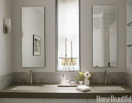 I love it when mirrors are stylized like a window. Creates a nice natural flow of things between the vanity sinks.