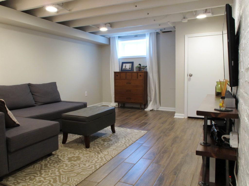 Cozy Chic Basement Reno With Exposed Painted Joists Wood Tile Floors Home Remodeling Basement Remodeling Small Basements