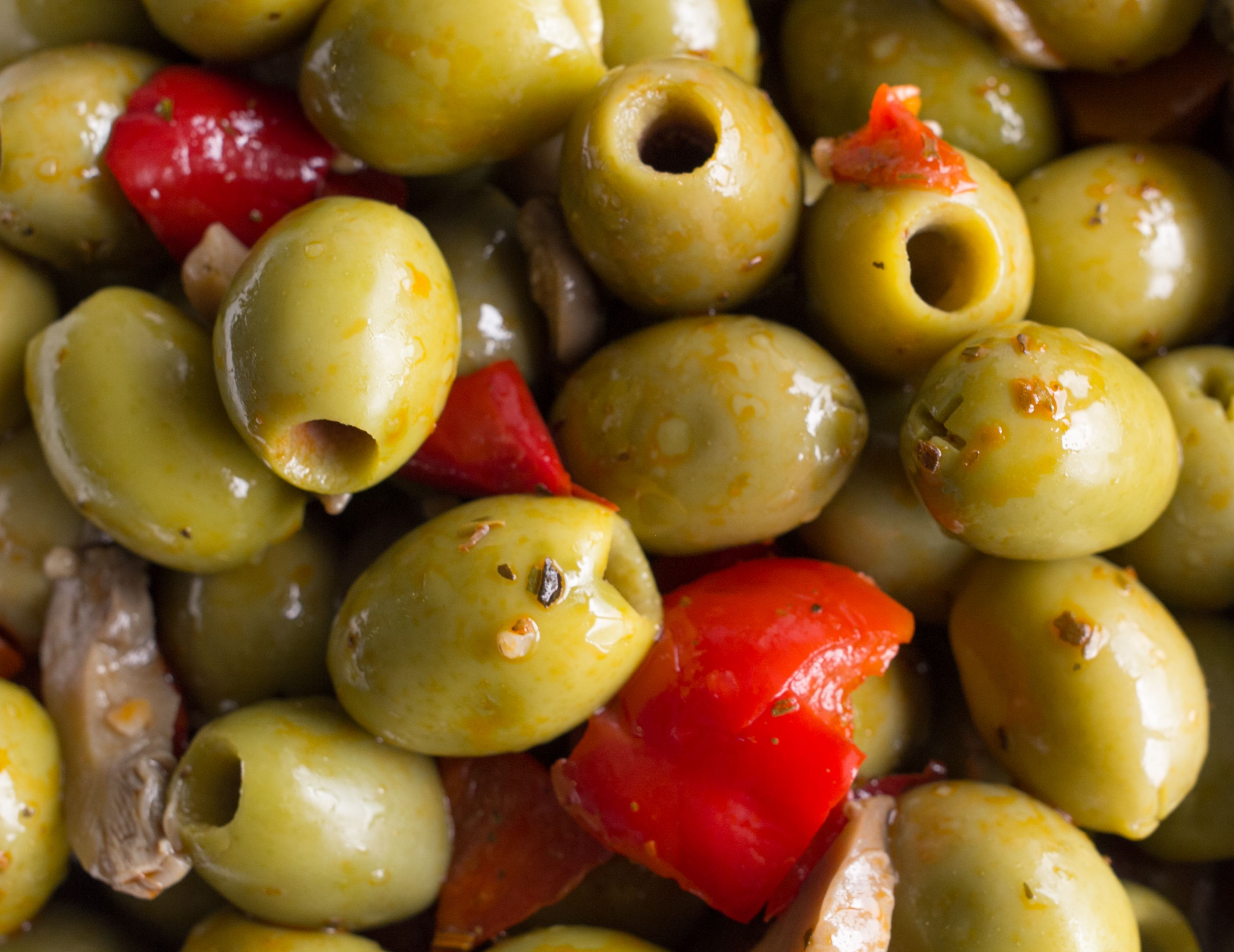 Snack Olives. Large pitted green olives with red peppers and garlic.  Tasty, healthy snack idea.