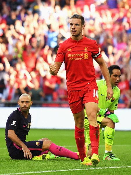 Jordan Henderson of Liverpool celebrates his team's second goal, an own goal by Javier Mascherano of Barcelona during the…