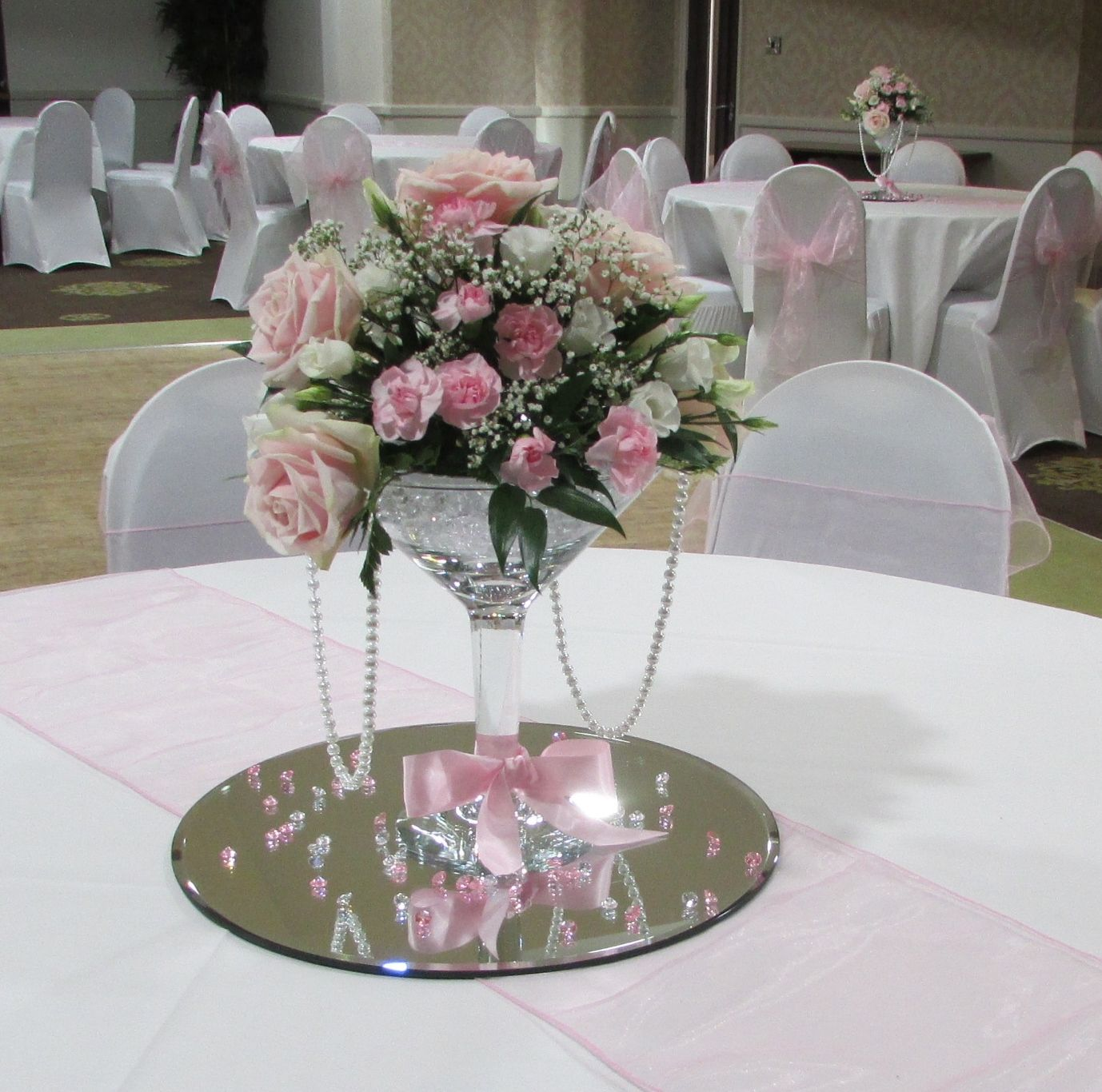 Grand Martini Vase With Fresh Flowers In Pinks Ribbon And Pearls Table Centrepieces For Hire