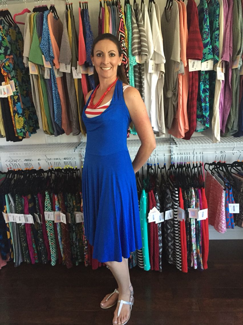 98f52e387d57fe How to style a LuLaRoe Nicole Dress as a Halter dress. Pull the sleeves up  around neck and pin it  ) www.styleandleggings.com