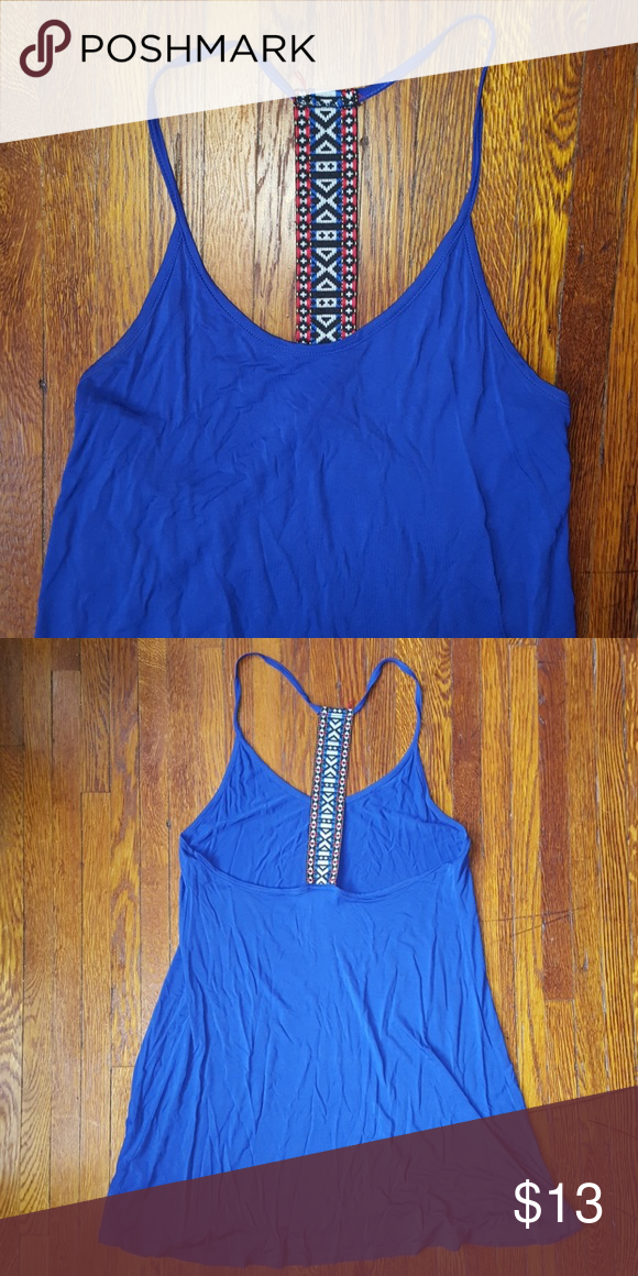 T.J. Maxx tribal racerback tank Purchased from T.J. Maxx. Light weight tank and long. [Length- 23 inches] Purple blue color. Great for summer!  Comment with any questions. No trades. Open to reasonable offers.  Thanks 🌼 B jewel Tops Tank Tops