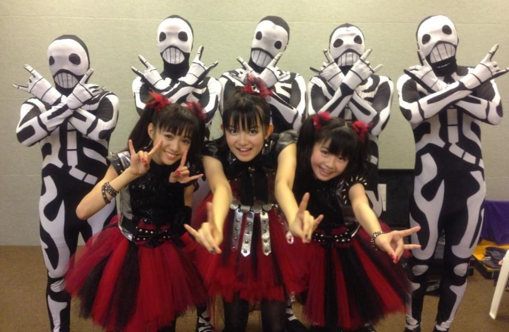 """BABYMETAL is a Japanese band that have a new type of genre: """"Kawaii Metal"""" meaning """"Cute Metal"""". It is a combination of J-Pop and Heavy Metal. They formed in 2011 when the three main girls: Suzuka Nakamoto/Su-metal [middle], Yui Mizuno/Yui-metal [right] and Moa Kikuchi/Moa-metal [left] were only 14 and 12 years old."""