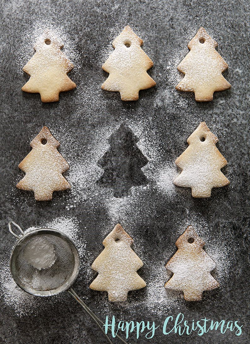 Rows Of Christmas Tree Shaped Biscuits Dusted With Icing Sugar With