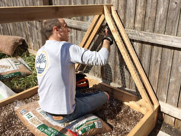 How To Build A Covered Raised Garden Bed: Attach Wire Mesh To Keep Out Pests