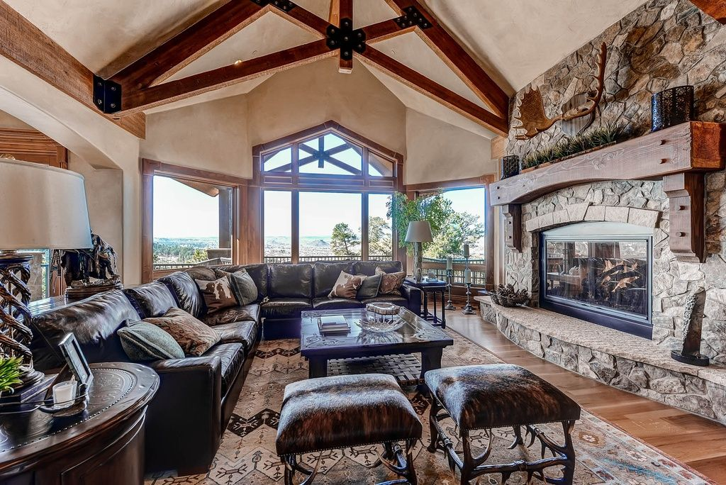 Great Rustic Living Room With Stone Fireplace Hardwood Floors In