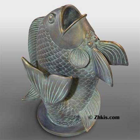 Fish shaped Vase. Unique vase shaped like a jumping fish. With mouth open it's ready for flowers. Great piece for a bathroom, Lake house or a beach house made of durable fiber stone several finishes to choose from