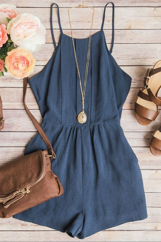 cc313fad8bf2 dusty blue romper with keyhole detail in back and paired with cognac  colored accessories.