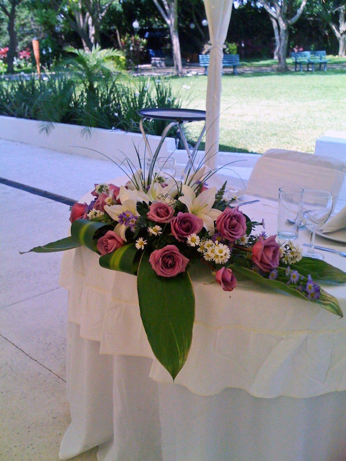 rosas lila para mesa de novios de florera el paraso en quinta pavo real del rincn